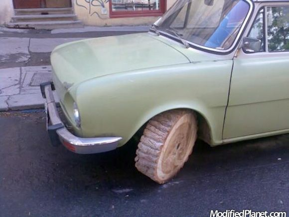 car-photo-block-of-wood-wheel-tire-fail